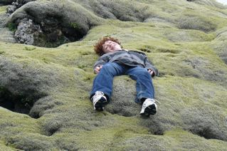 kid outside laying down in iceland