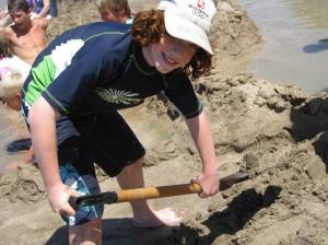 kid playing at hot water beach