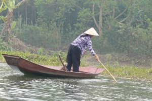 Vietnamese woman working on the river